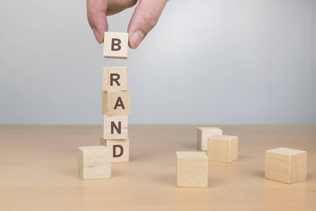 brand word written wood block
